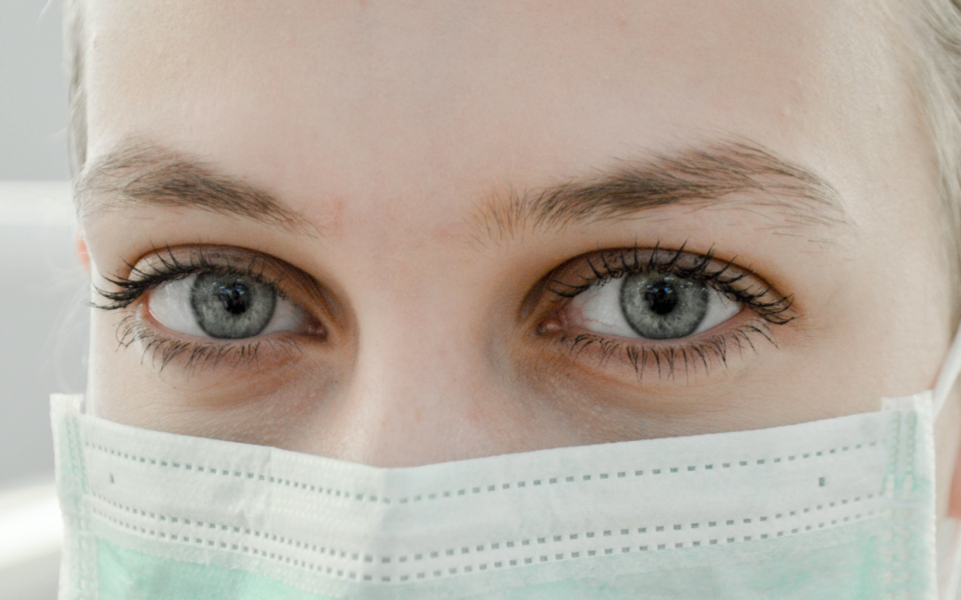 Close-up of woman with surgical face mask